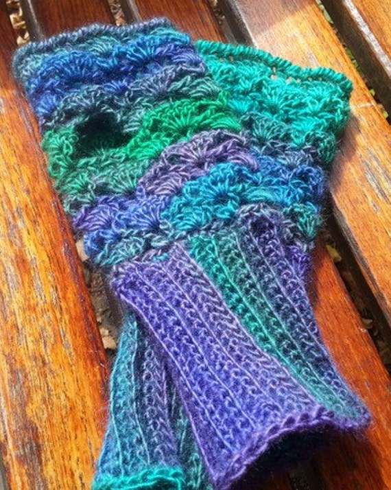 The Best Hand Crocheted Fingerless Texting Gloves in shades of purple, green and blue.