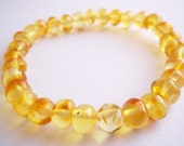 Polished    Baltic  Amber  Bracelet . Golden colour  7.5  inches.