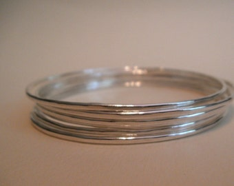 Set of 6 thin, stacking sterling silver bangles