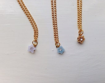 tiny flower -necklace (tiny fimo clay pink tone flower with crystal stone on a gold plated chain)