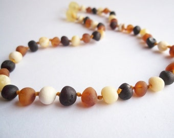 Maximum Effective Raw Unpolished Baltic Amber teething necklace for your baby handmade knotted. Multicolor.