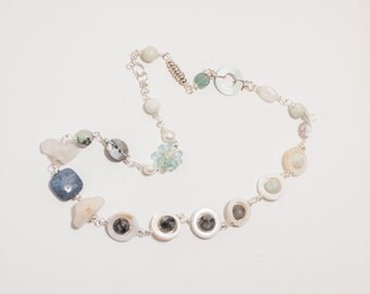 Blue and White Abstract Necklace featuring a variety of beads including mother of pearl amazonite jasper Czech glass on silver plated wire