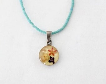 vintage turquoise pendant necklace with pressed flowers