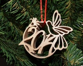 2014 Christmas ornament delicately carved from maple