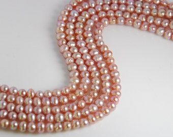 20 pearls: 4.5-5mm off round freshwater pearls, grade AA, natural mauve color