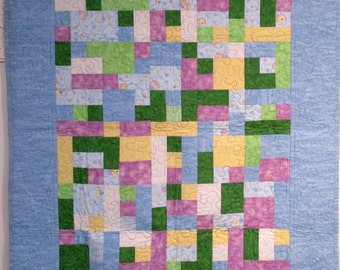 collage quilt with a blue border