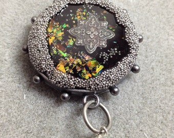 Multi layer glitter resin silver tone pendant