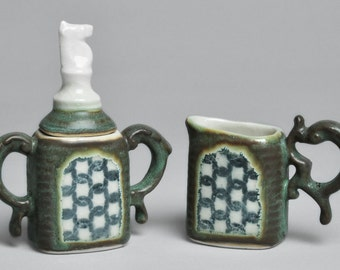Weathered Green and White Knight Ceramic Cream and Sugar Set