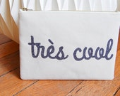 "Zippered clutch ""très cool"""
