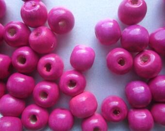 Fuschia Wood Beads 10x9mm 28 Beads