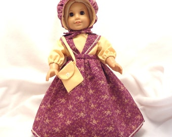 Five-piece outfit for 18 inch dolls.  Blouse, Jumper, Pantaloons, Bonnet, and Purse.
