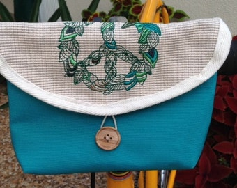 Embroidered Peace Sign Bag on Textured Flap With Teal Body