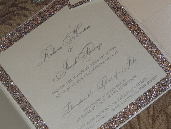 Exclusively from our All That Glitters Invitation Collection.... these handmade wedding invitations with crystal