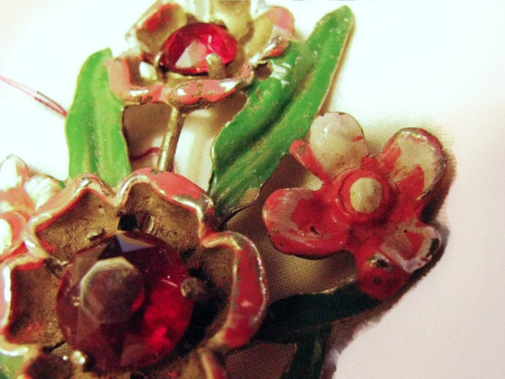 1920s or 30s pot metal brooch in pink red and green enamels. floral spray is 3 inches top to bottom.