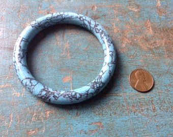 Turquoise blue solid bangle with beautiful veining, approx 2-1/2 inch diameter opening