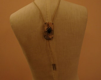 Western style silver Bolo ties