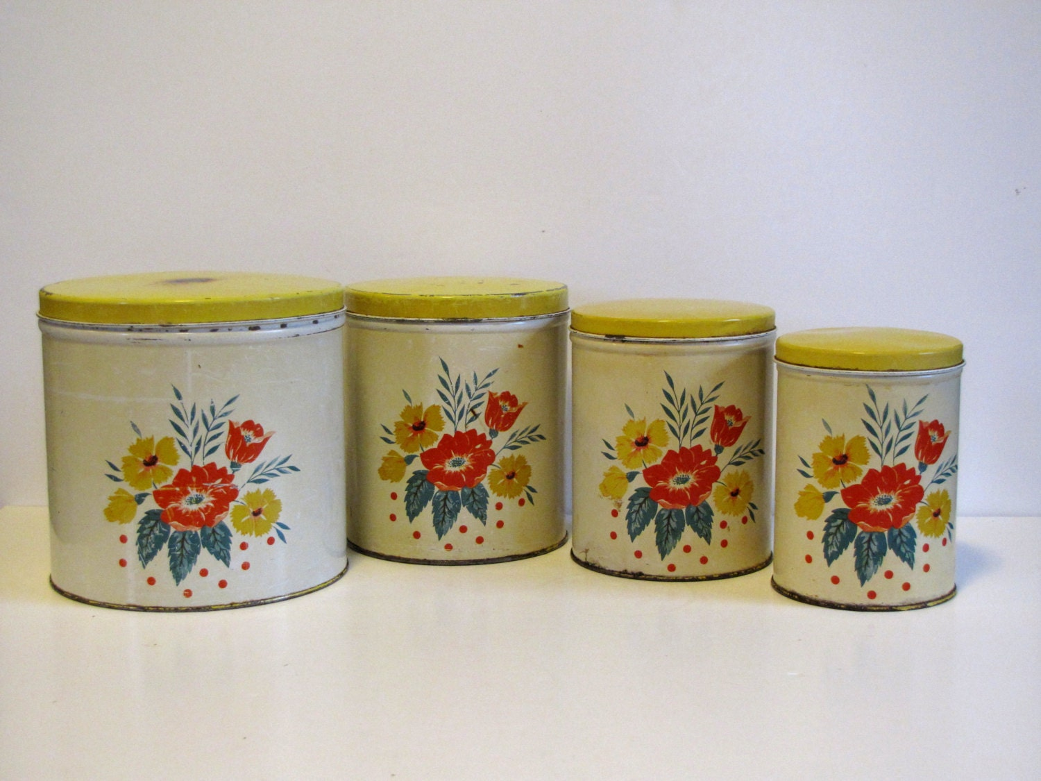 vintage yellow metal floral canisters set of four