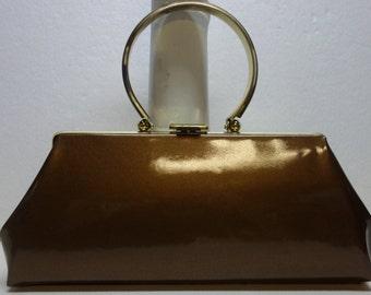 PATENT oblong 60s purse w/metal Bracelet Handle
