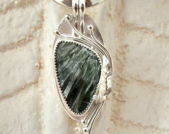 "Seraphinite pendant.  Sterling silver bezel set.  hand forged. ""Vine with me"""