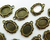 12 cabochon settings, 8x6mm, bronze, oval