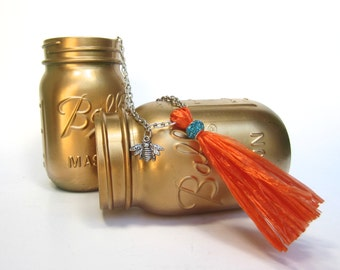 Abigale 15 inch orange tassel necklace in vintage Swistraw with bumblebee charm and pool blue rhinestone by Ruby Buffalo.