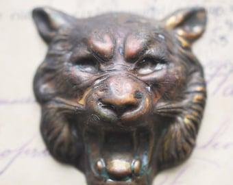 Growling  tiger brass stamping, honey patina