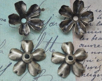 FOUR flower bead caps, oxidized brass