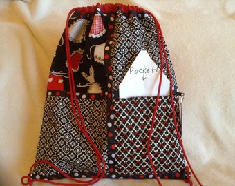 Retro aprons with red black and white on a red ripstop nylon drawstring backpack with front zipper pocket