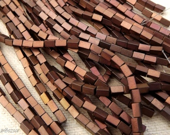 Hematite beads, 4mmx 2mm rectangles, soft matte brown with rose and gold highlights, two 11 inch strands