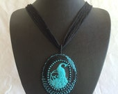 Blue and Black Peacock Pendant on a Silk Ribbon Necklace