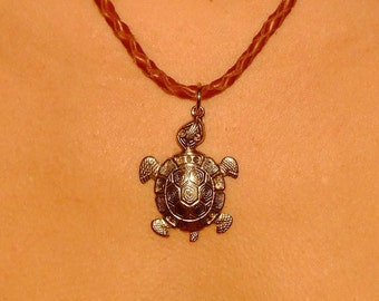 Braided leather necklace with metal turtle pendant