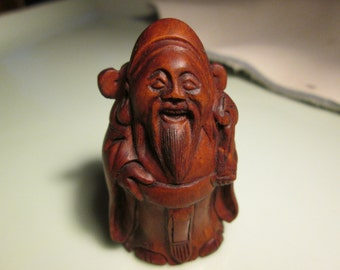 netsuke hand carved HAPPY MONK heavy detailed carving cherry stain on birch wood 2 inches very collectible