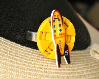 Vintage Rocket Ship Whimsical Ring, blasting across the yellow sun upcycled button tin toy image, silver adjustable band, funky geeky gift
