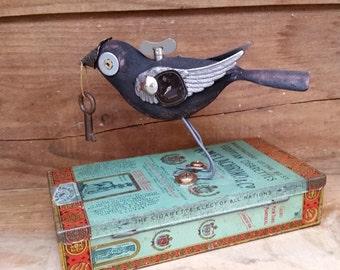 Hand carved assemblage art bird mixed media art vintage tin altered art