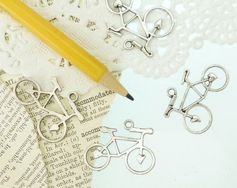 4 bicycle charms in antique silver