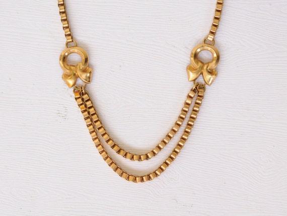 1920's / Art Deco brass necklace / festoon // BOWS