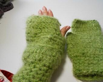 Soft green yarn in these fingerless gloves.