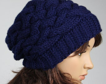 Hand knitted ladies slouchy beanie. A lovely hat available in navy blue.