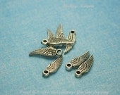 Angel Wing Charm 8 Charms Silver Plastic 17 x 5 mm -  pa097