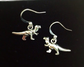 T-Rex Earrings. Dangle Earrings. Simple. Silver. Minimalist. Natural History. Dinosaur Jewelry. Charms. Small Charms. Under 10. Rawr.