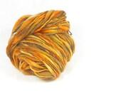 Tiger - Thick and thin yarn. Hand spun, from hand painted top, slub yarn. Pure Australian 21 micron merino wool.