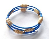 Memory wire bracelet with faux bone beads in blue