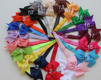 7 baby girl bows - 2 dollar each - baby girl bow and headband - baby headband - headband bow - headband. You can choose colors.