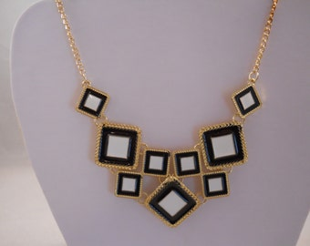 Black and White Beads on a Gold Tone Chain Bib Necklace
