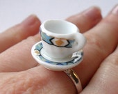 Mini ceramic tea cup ring with blue art deco pattern