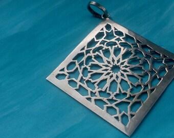 Moroccan sterling silver hand cut arabesque tile pendant