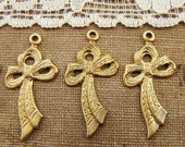 Elegant Raw Brass Bow Charms Pendants - 6 - alyssabethsvintage