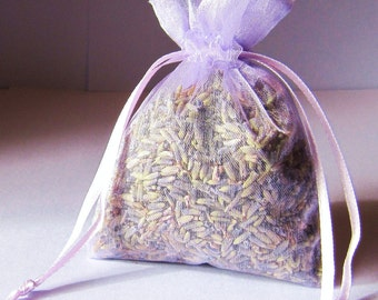8 3x4 lavender color sachets filled with dried lavender