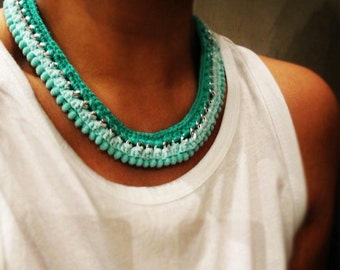 Crochet and pompoms chain necklace in shades of turquoise