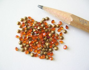 50 Swarovski Sun orange crystal rhinestone chaton with gold foil. SS7  2.1-2.3mm